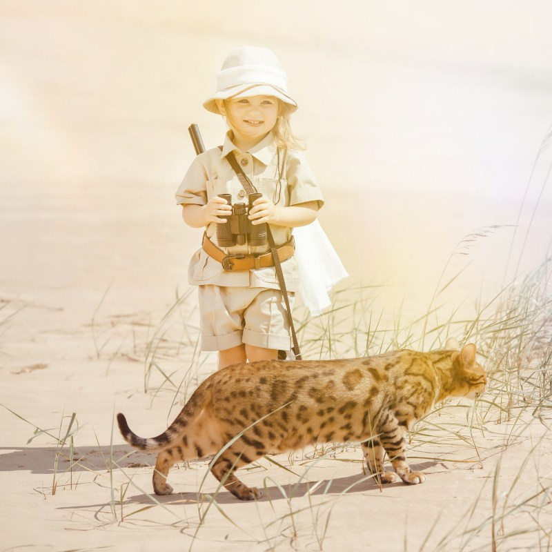 Child pretending to be on a safari