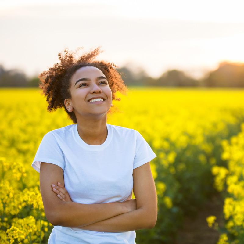 Teen smiling in a flower field