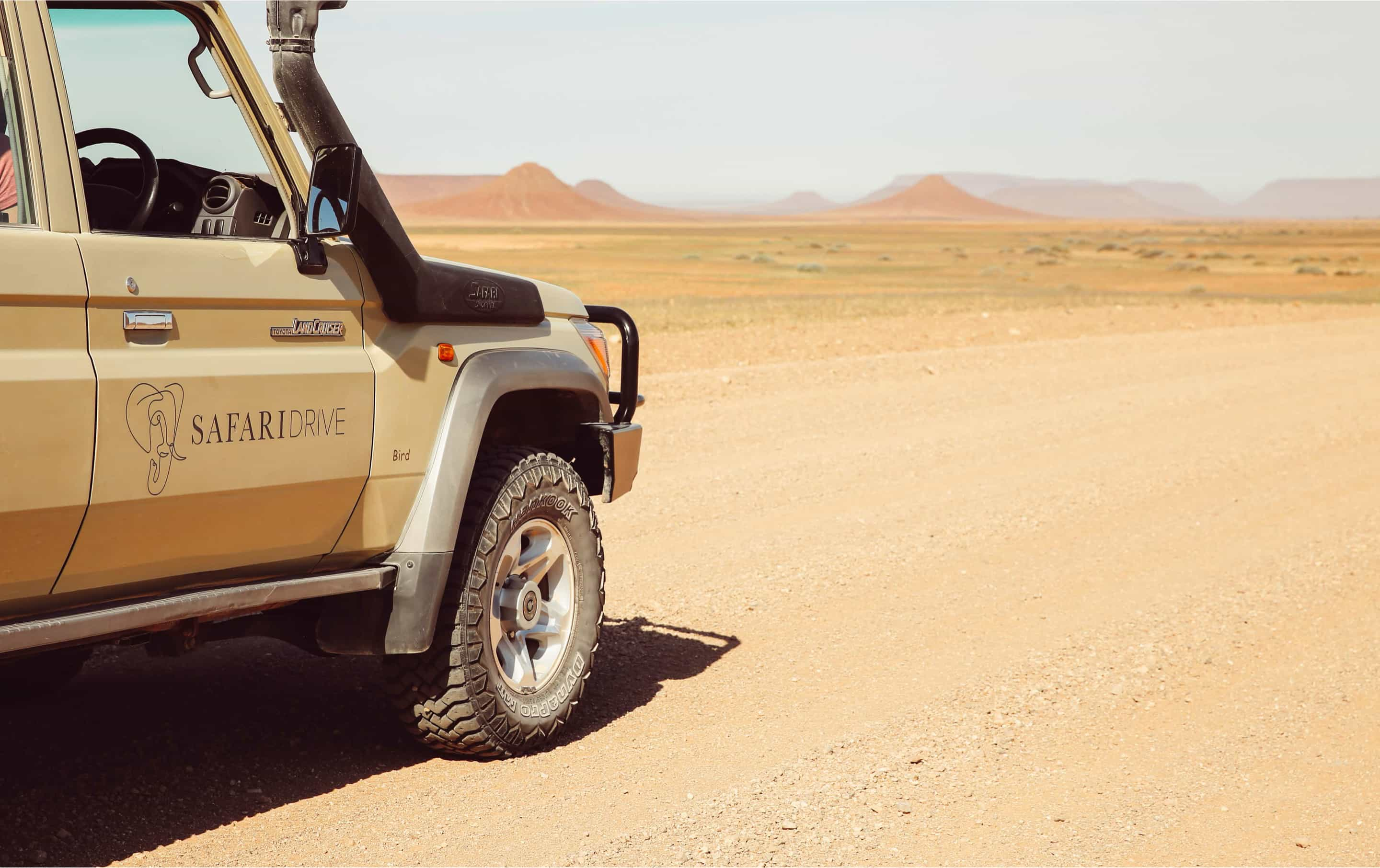 Landscape image of the new Safari Drive branding on a Land cruiser in Namibia