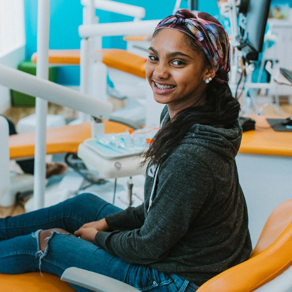 Photo of a smiling teenage patient wearing braces