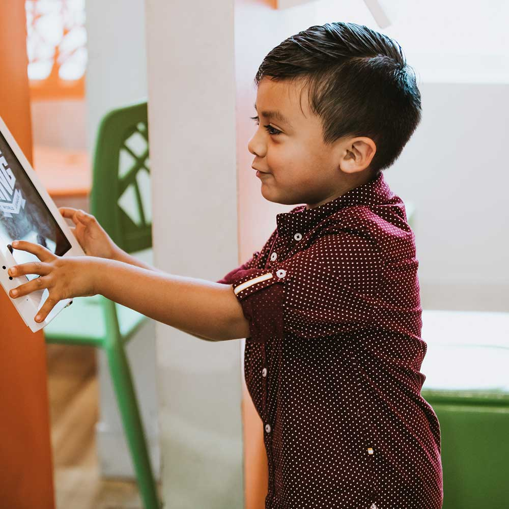 Photo of a young patient using an iPad
