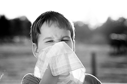 young boy suffering from allergies