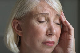 person suffering with sinus pain