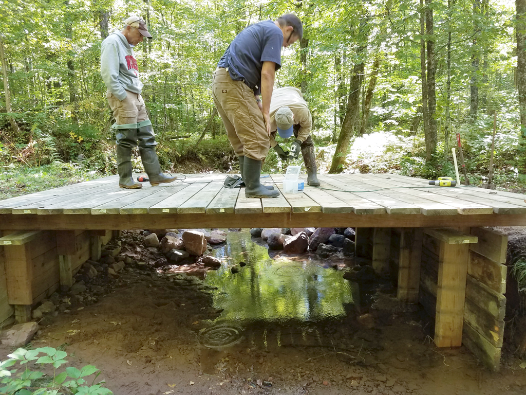 applying the decking on the repaired bridge