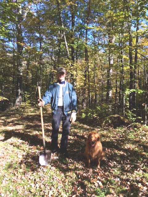 man and his best friend at the annual work day of the Blue Hills Trail