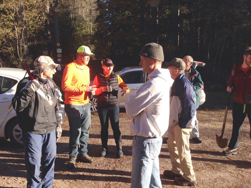volunteers gather prior to heading out to work on the ski trail