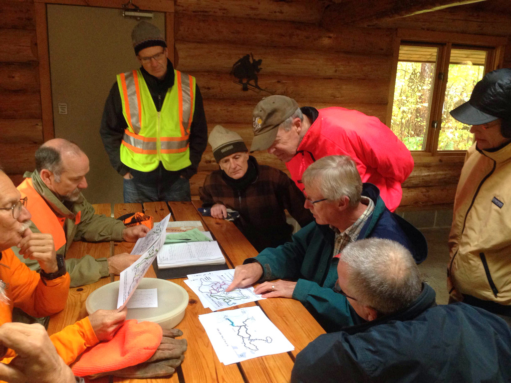 volunteers meet inside the warming house at the Blue Hills Trail