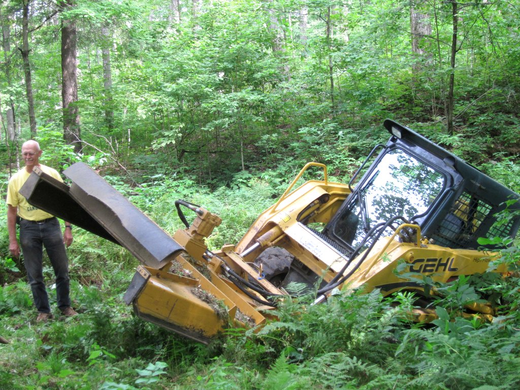 skidsteer slipped off the edge of the trail