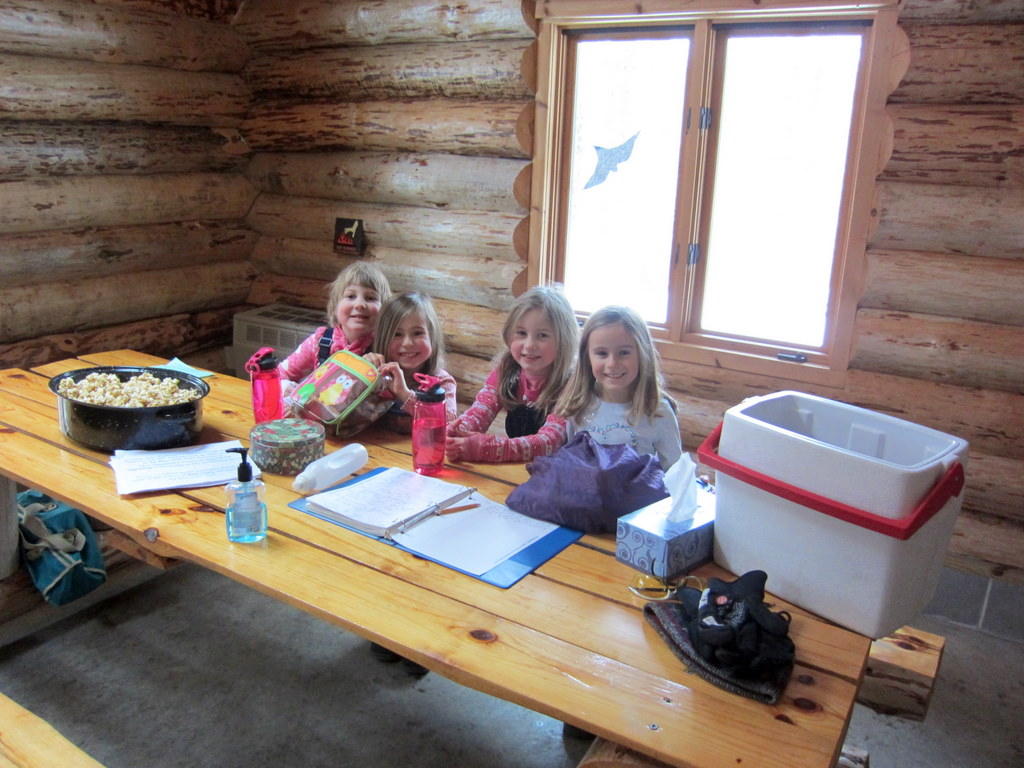 kids enjoying a snack inside the warming house of the Blue Hills Trail