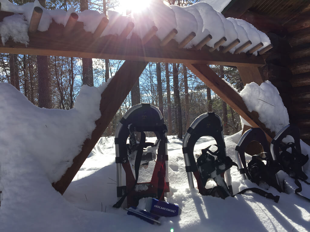 snowshoes resting outside the warming house
