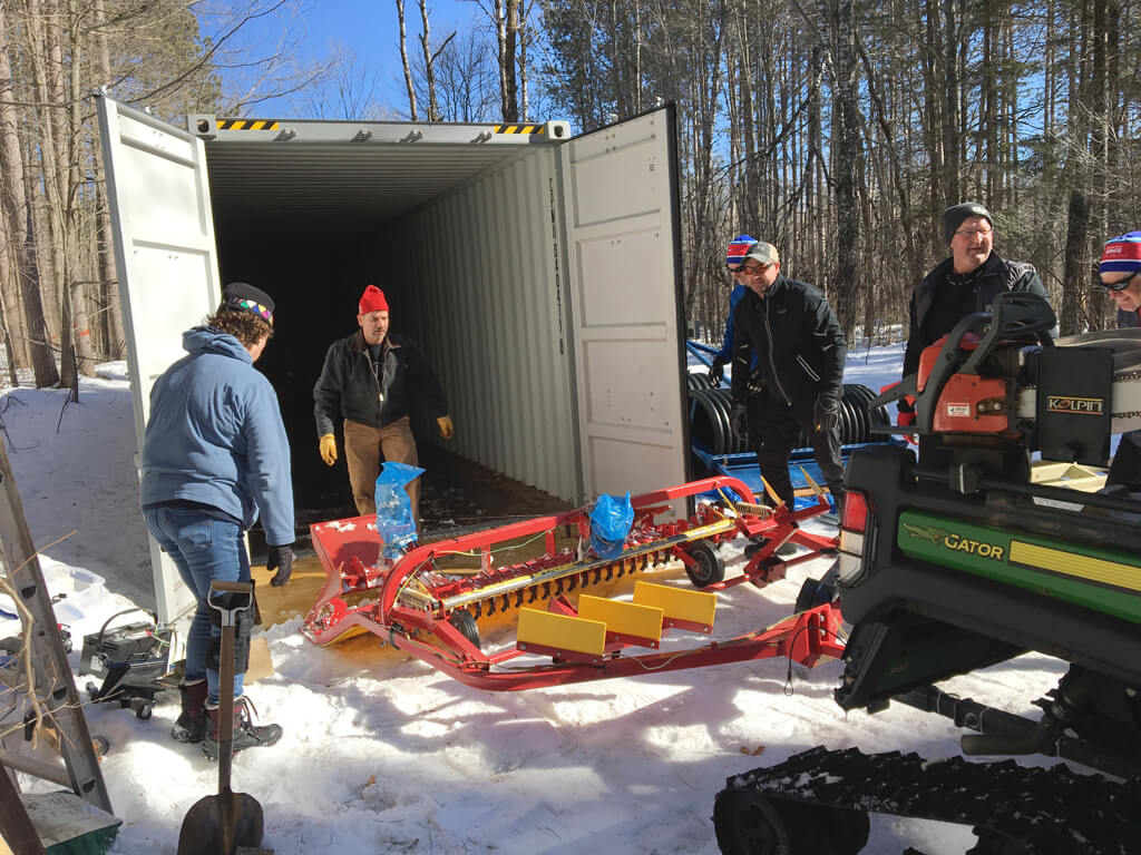Blue Hills Trail volunteers help move equipment into storage