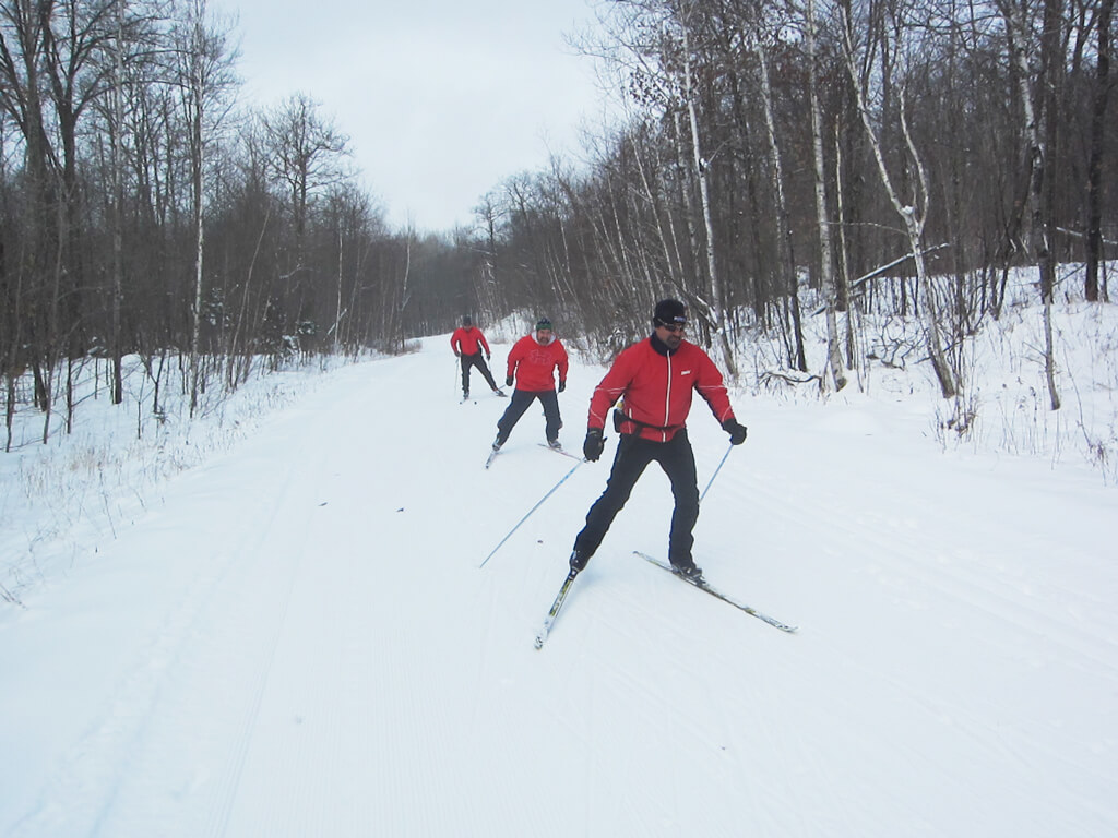 skate skiing on freshly groomed trails at the Blue Hills Trail