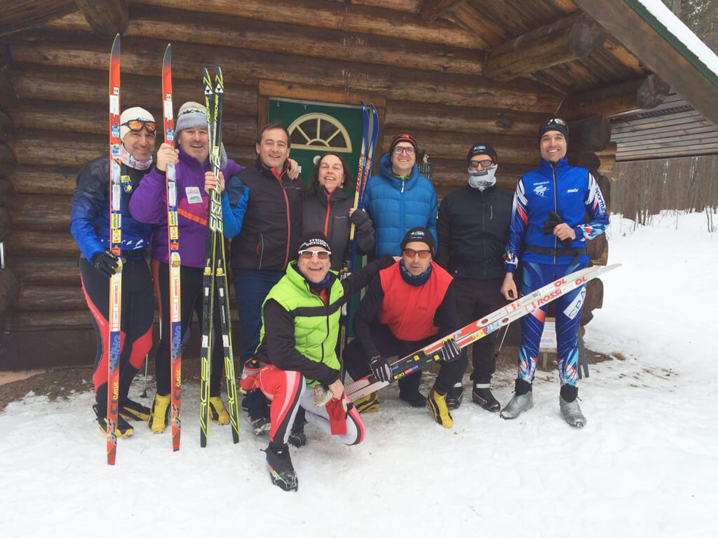 an enthusiastic group of skiers from Andorra posed for a photo at the warming house