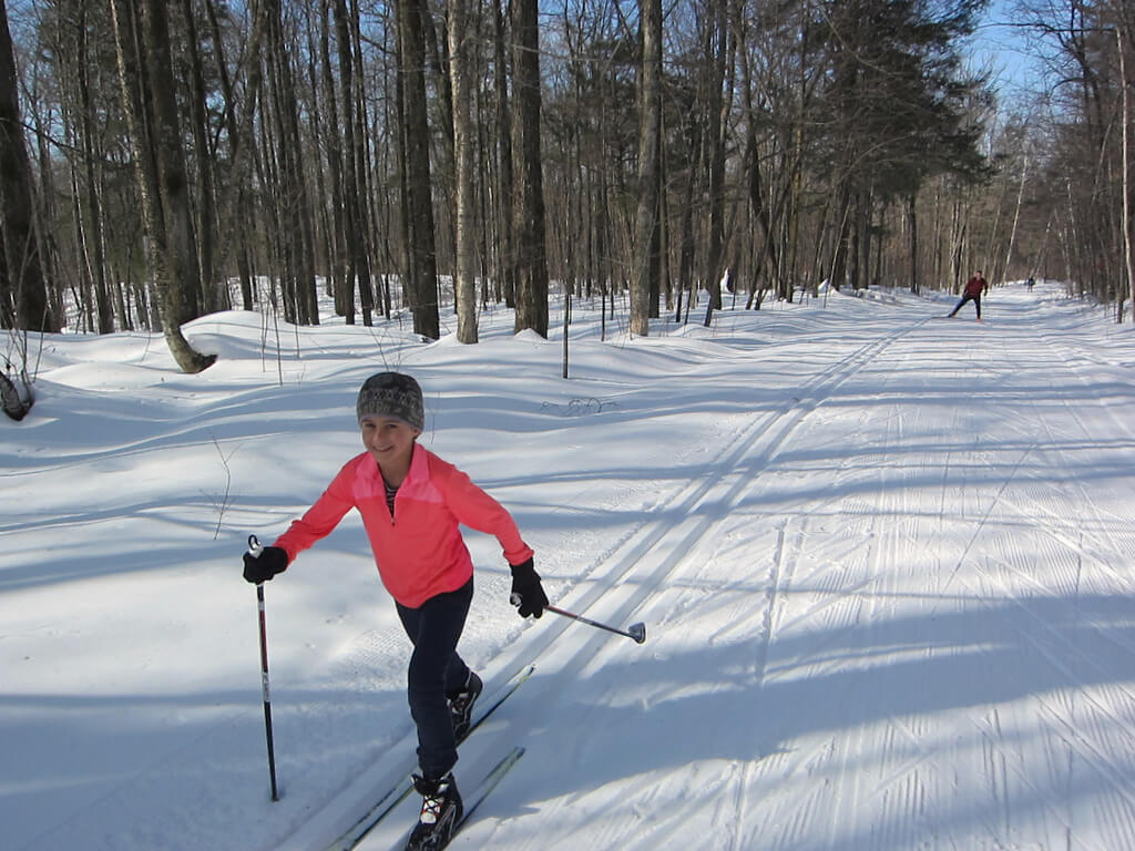 happy young skier at the Blue Hills Trail