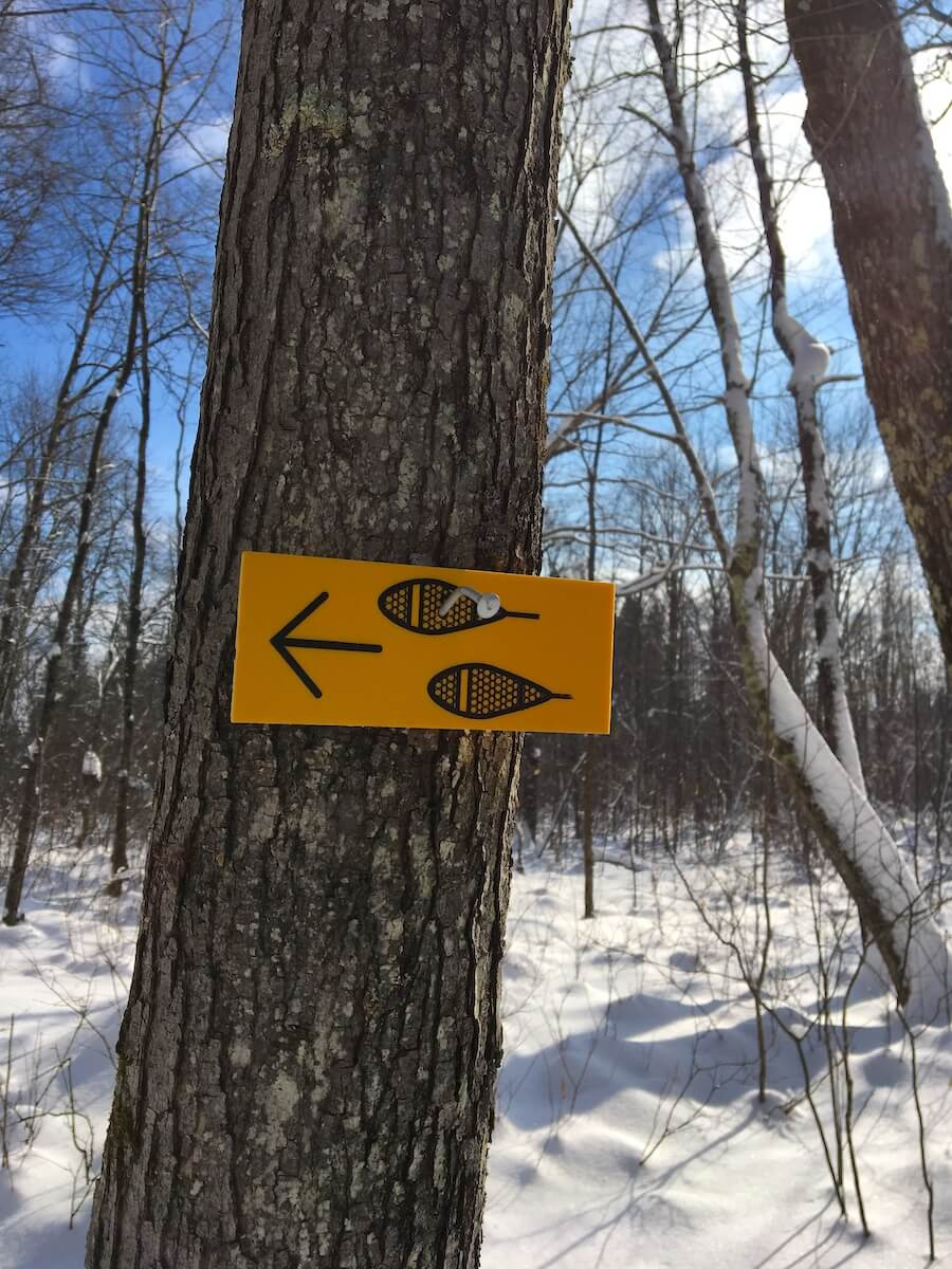 Wisconsin Blue Hills Trail sign on snowshoe trail