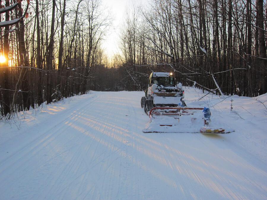 Gator 825i pulling TiddTech snow groomer