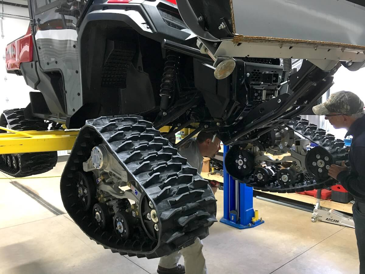 Our Honda Pioneer on the rack while Mattracks are installed