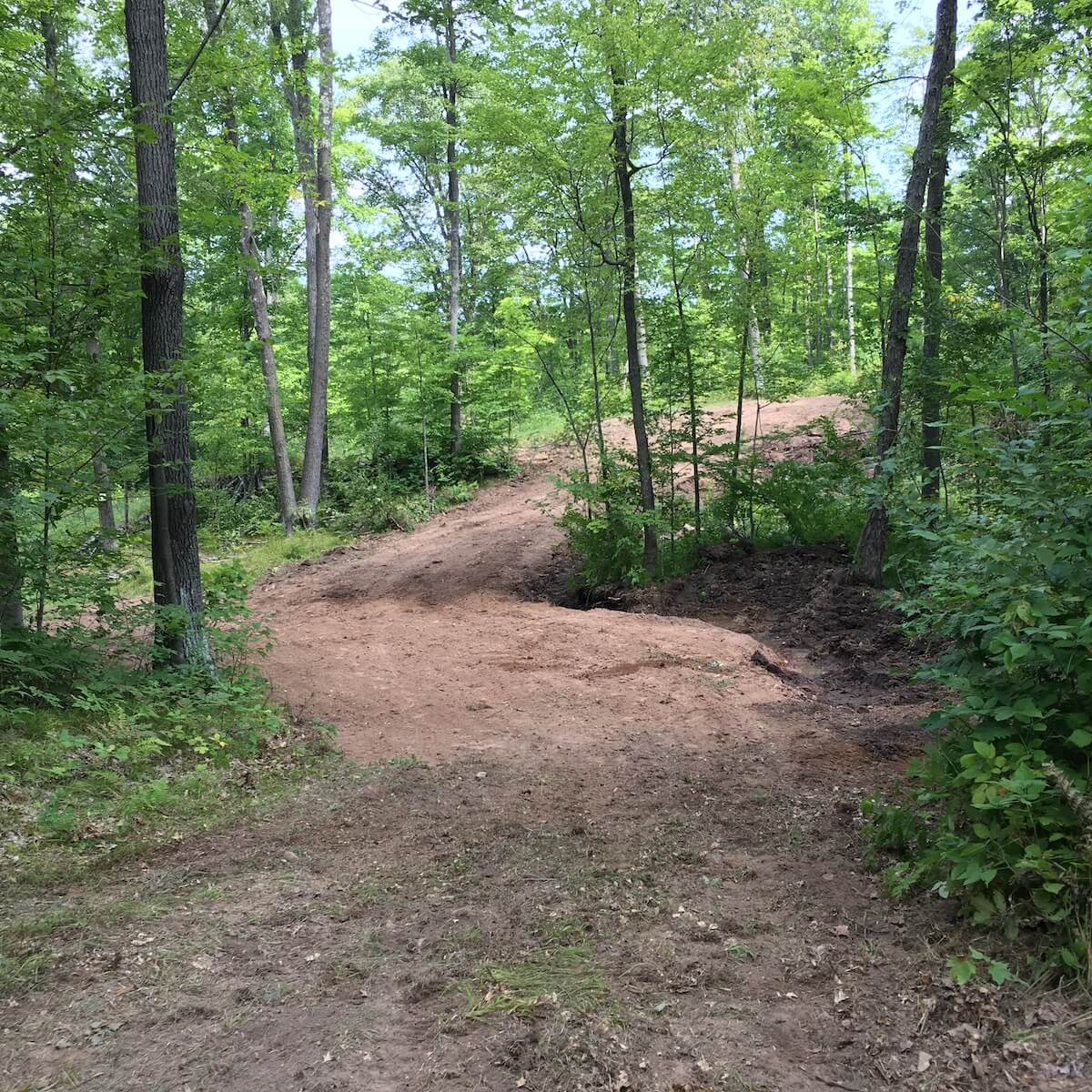 Bulldozing on Blue Hills Trail at the Roundabout intersection