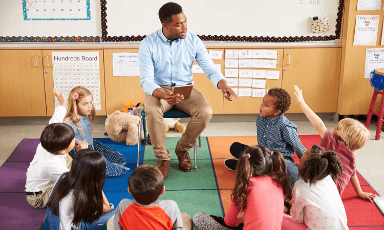 teacher reading to students in a circle
