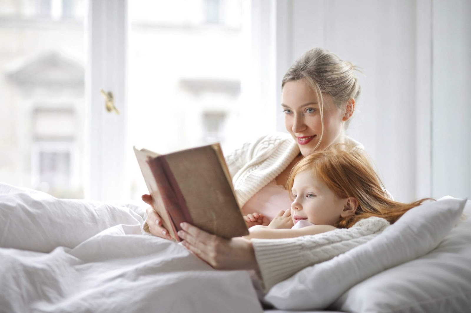 woman reading with young girl