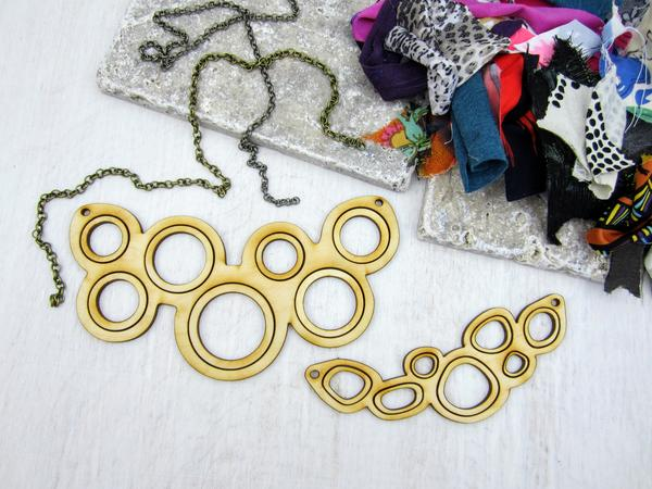DIY Necklace Workshop, empty wood necklaces with a pile of fabric
