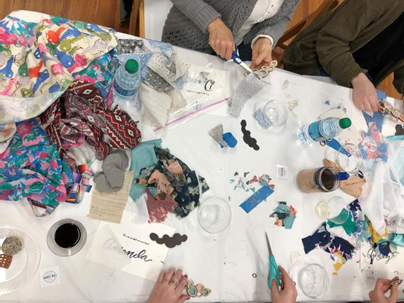 image from above table with fabric pieces spread out haphazardly