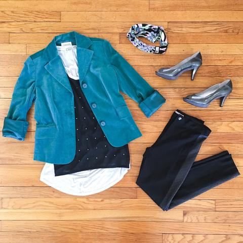 Flat lay: teal, velvet blazer with a black, studded, flowy tank, and black, sleek skinny jeans, metallic heels, and Regenerous Designs headband.