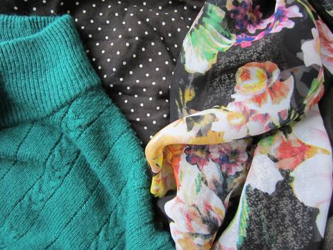 Colorful floral print, teal sweater knit, black and white polkadot print.