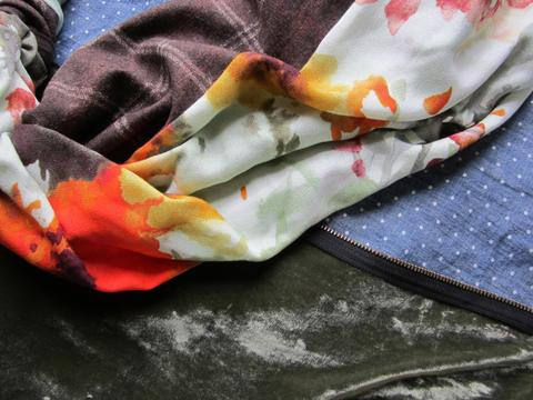White polkadot denim, green-orange watercolor floral print, moss green velvet fabric.