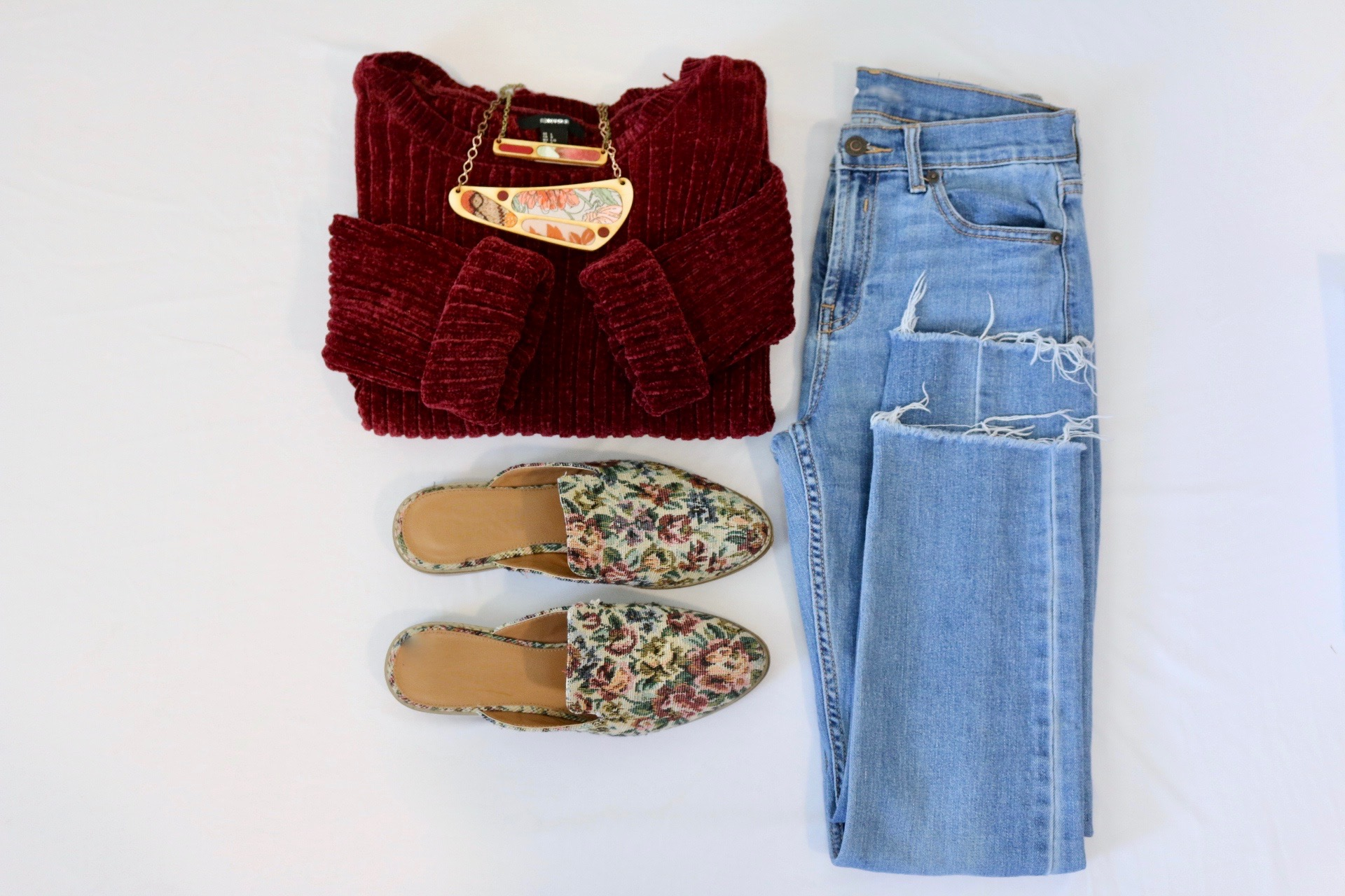 Red Sweater Paired with Regenerous DesignsNecklaces, jeans, and floral pattern shoes
