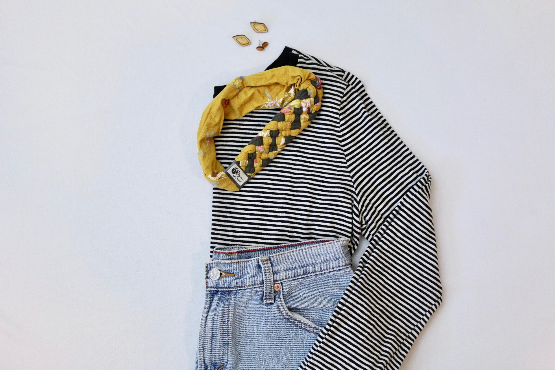 Black and white striped top with Regenerous Designs Big Braided Headband, stud earrings, and jeans.