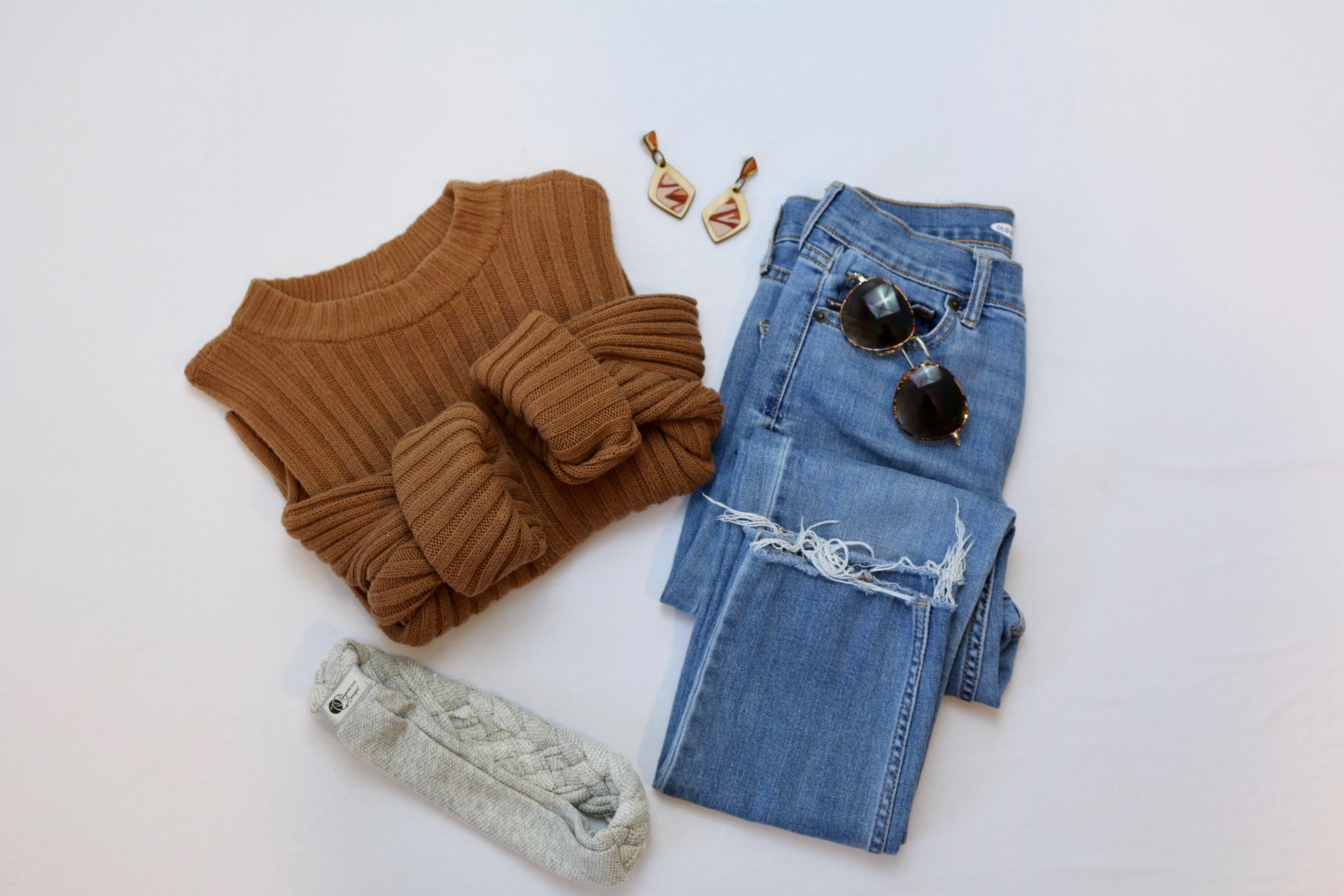 Burnt orange sweater with Regenerous Designs Dangle Earrings, The Big Braided Headband, and jeans.