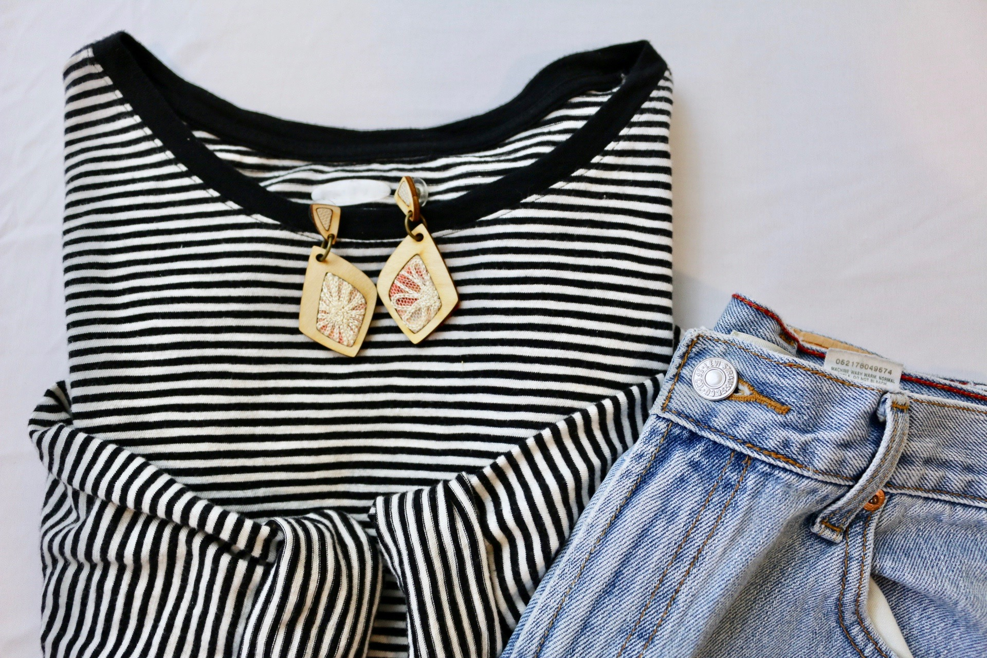 Black and white striped top styled with Regenerous Designs Dangle Earrings and jeans.