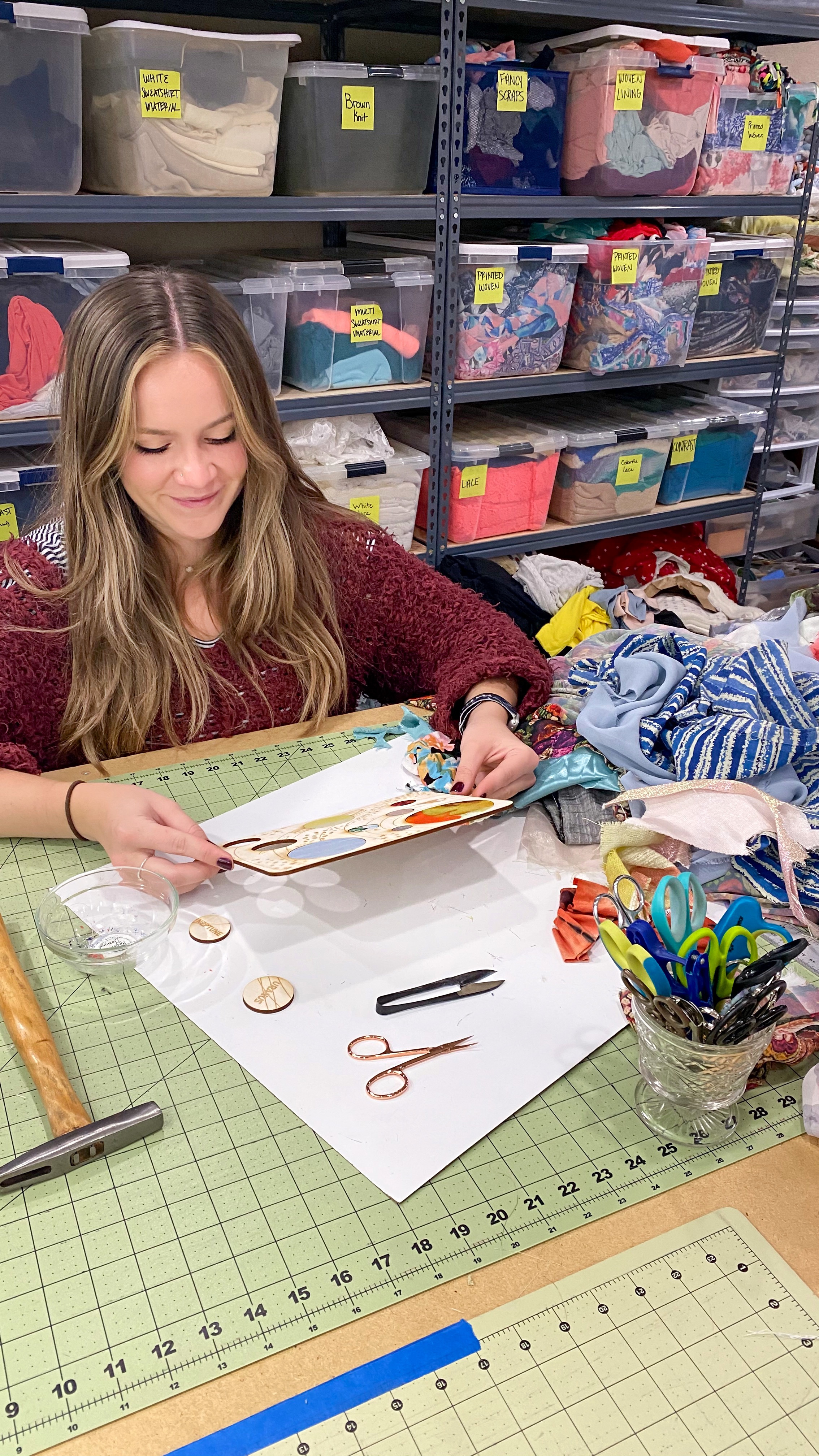 Intern Cassidy Dutton working on her DIY educational art kit craft project for kids - textile and wood solar system space galaxy planets astronaut
