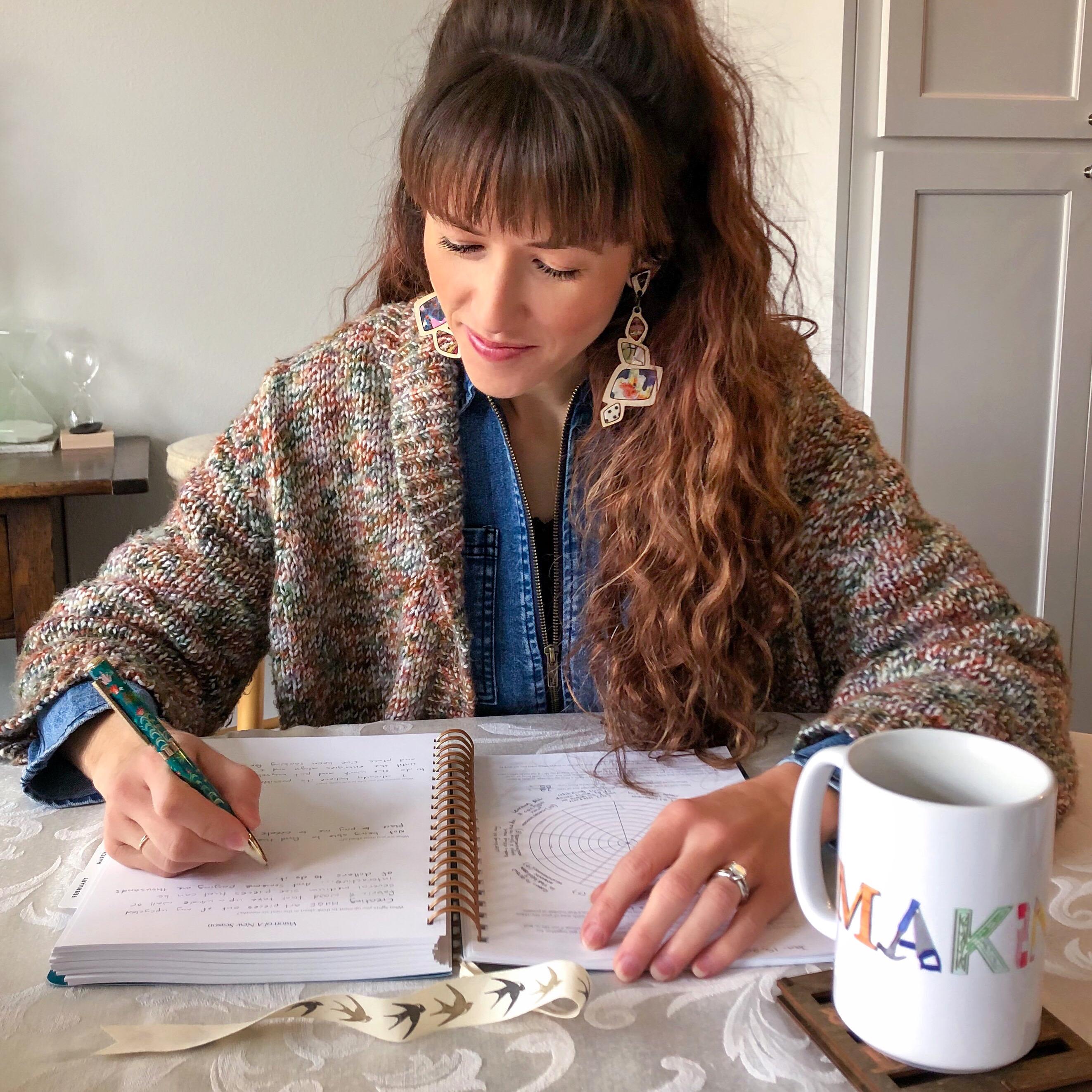 Alyssa Bird filling out her Goals Journal for 2020