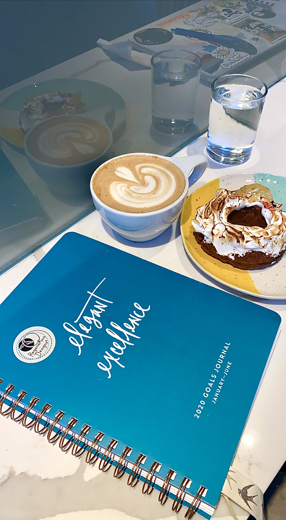 Elegant Excellence Goals Journal with a yummy coffee and donut from Onyx Coffee Lab