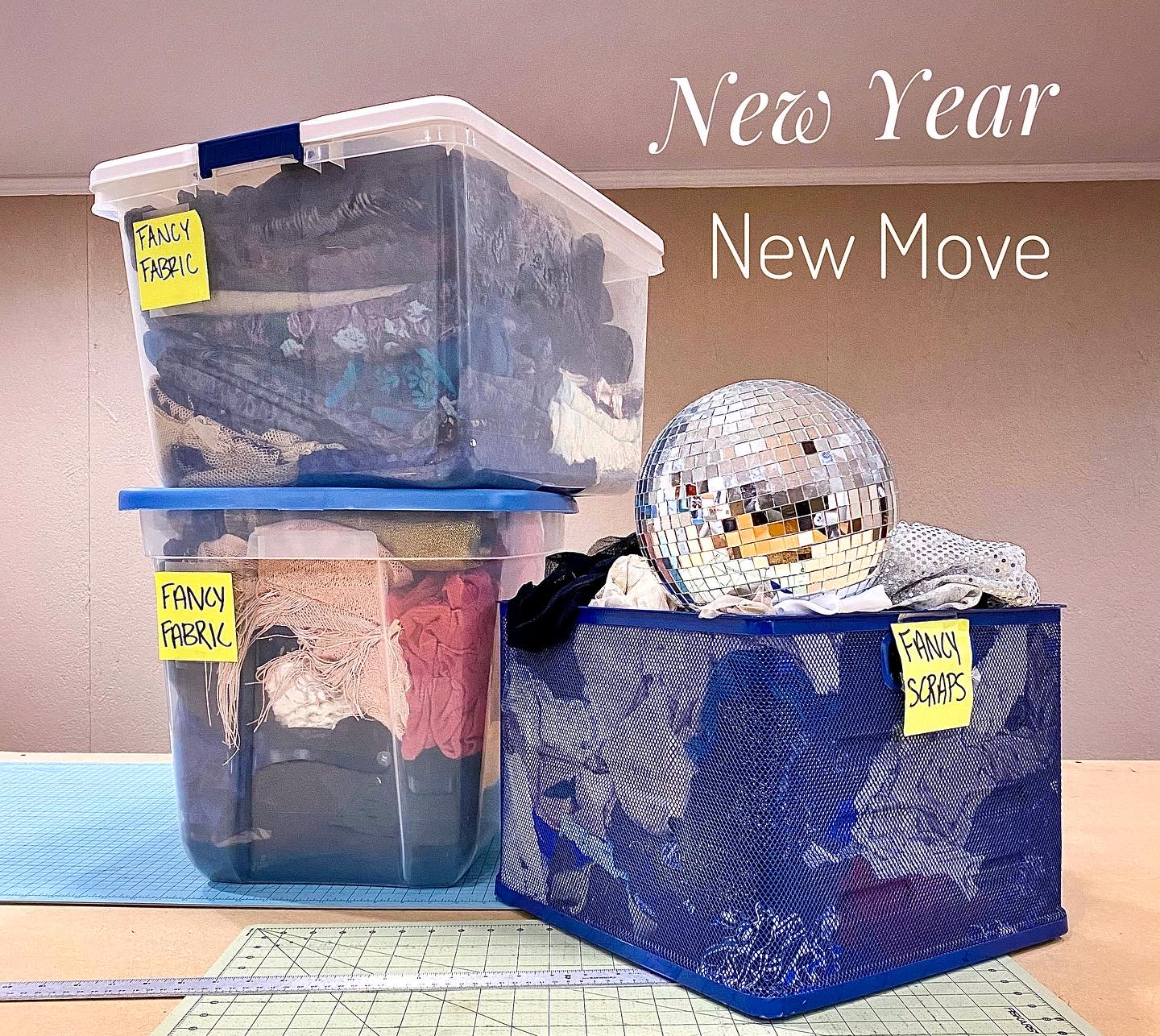 Boxes of fabric and a disco ball. New Year. New Move