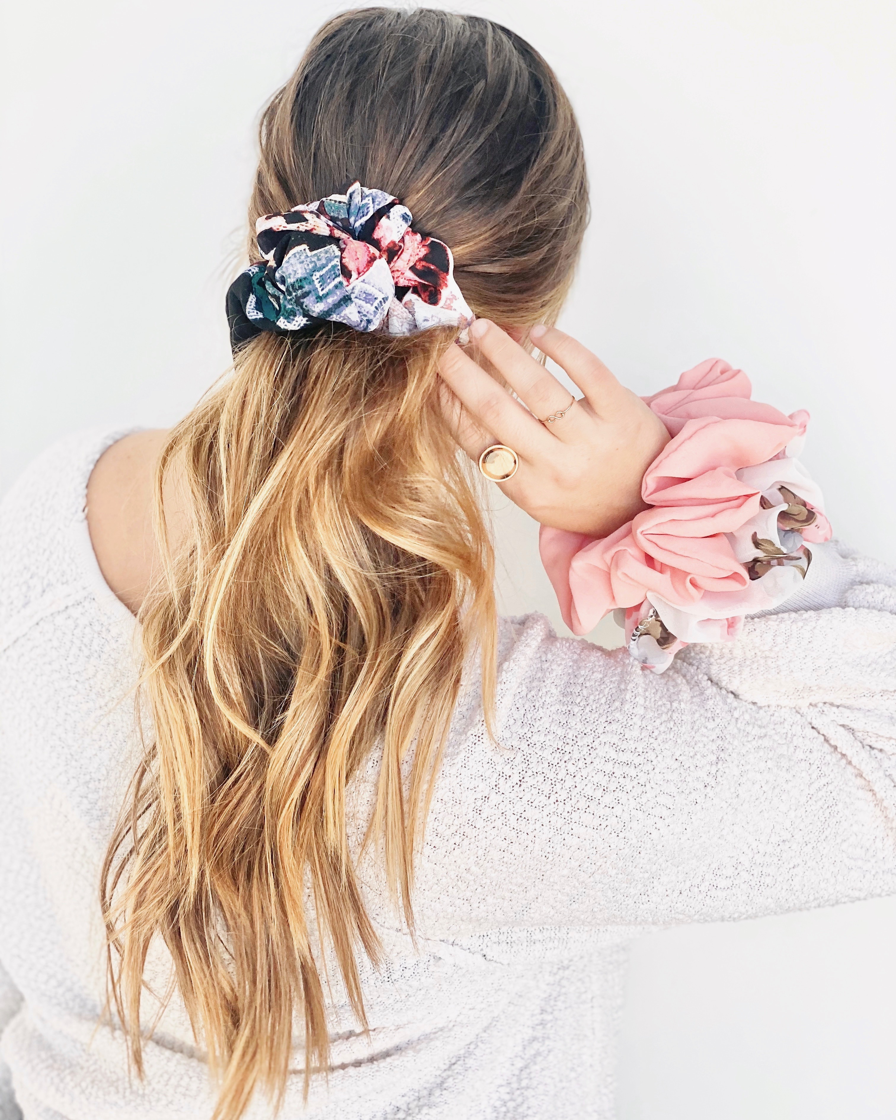 Regenerous Designs scrunchies in a girl's hair and on her wrist