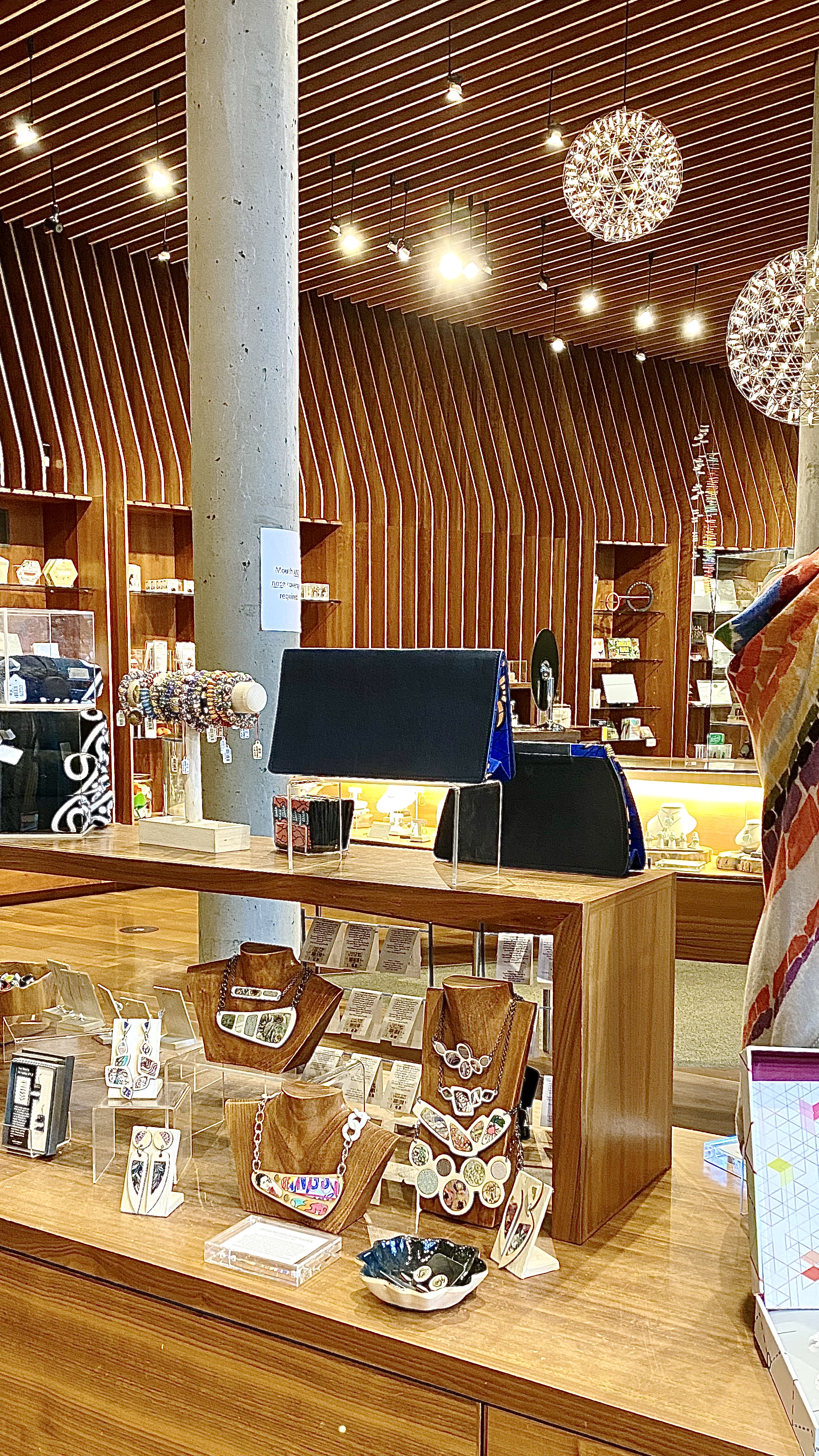 Custom one of a kind Regenerous Designs art jewelry featured at Crystal Bridges Art Museum gift shop