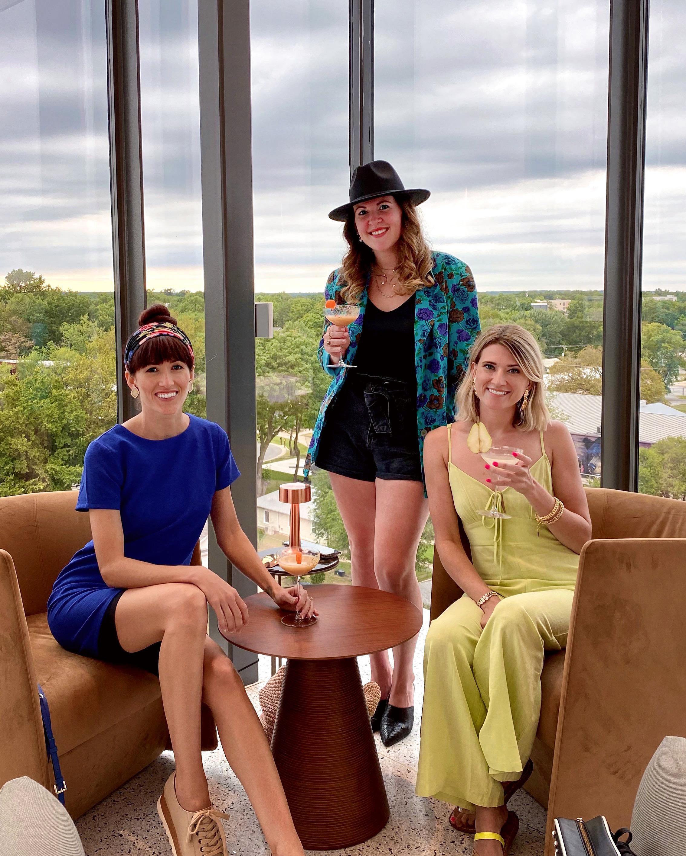 Alyssa Bird with her friends at the Momentary Art Museum roof top bar in Bentonville, AR