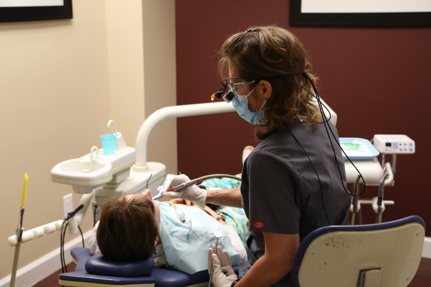 dental assistant working on a male patient