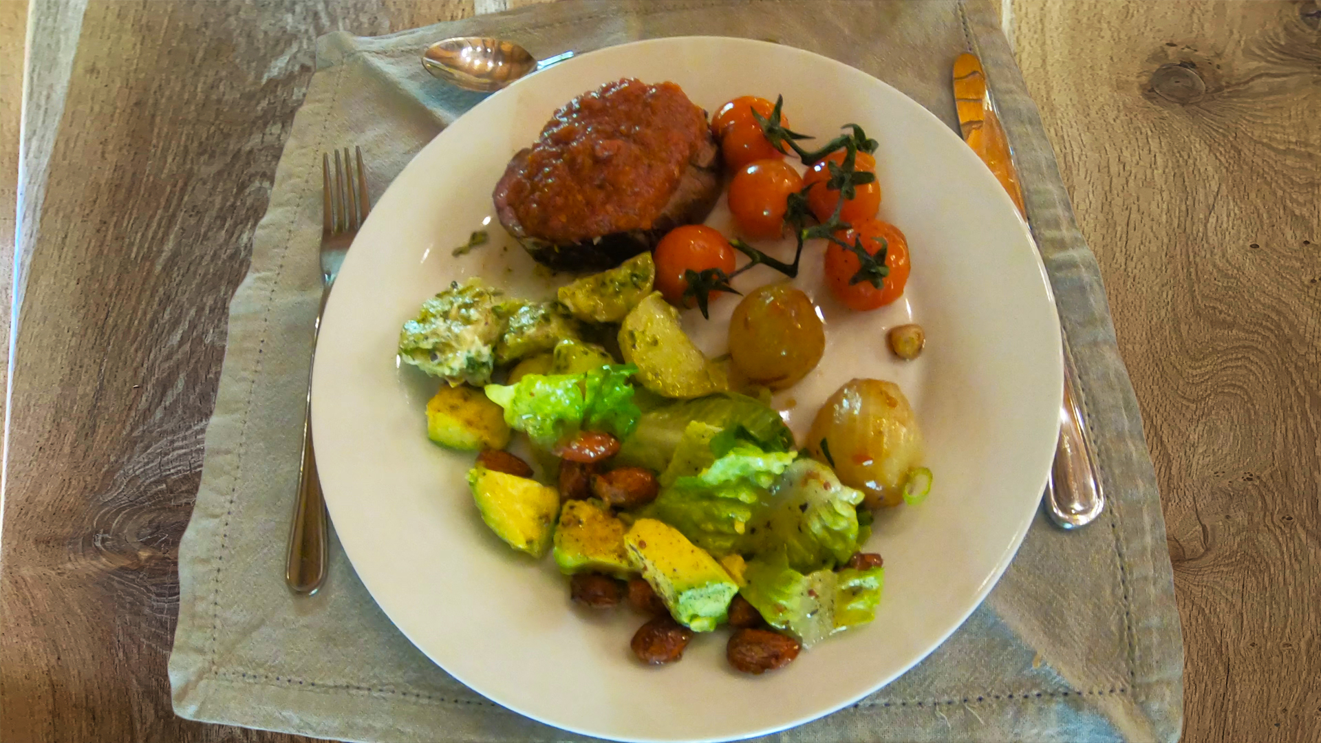 #ZZ2Festive Food main course of Chargrilled whole filled, caramelized onions, vine tomatoes, avocado salad, potatoes and potbrood with butter.