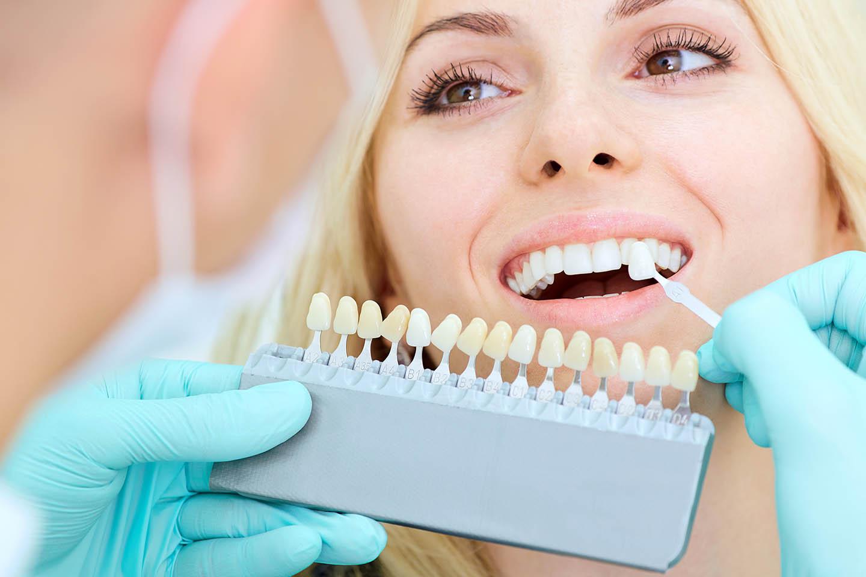 Woman getting a veneer fitted to her teeth