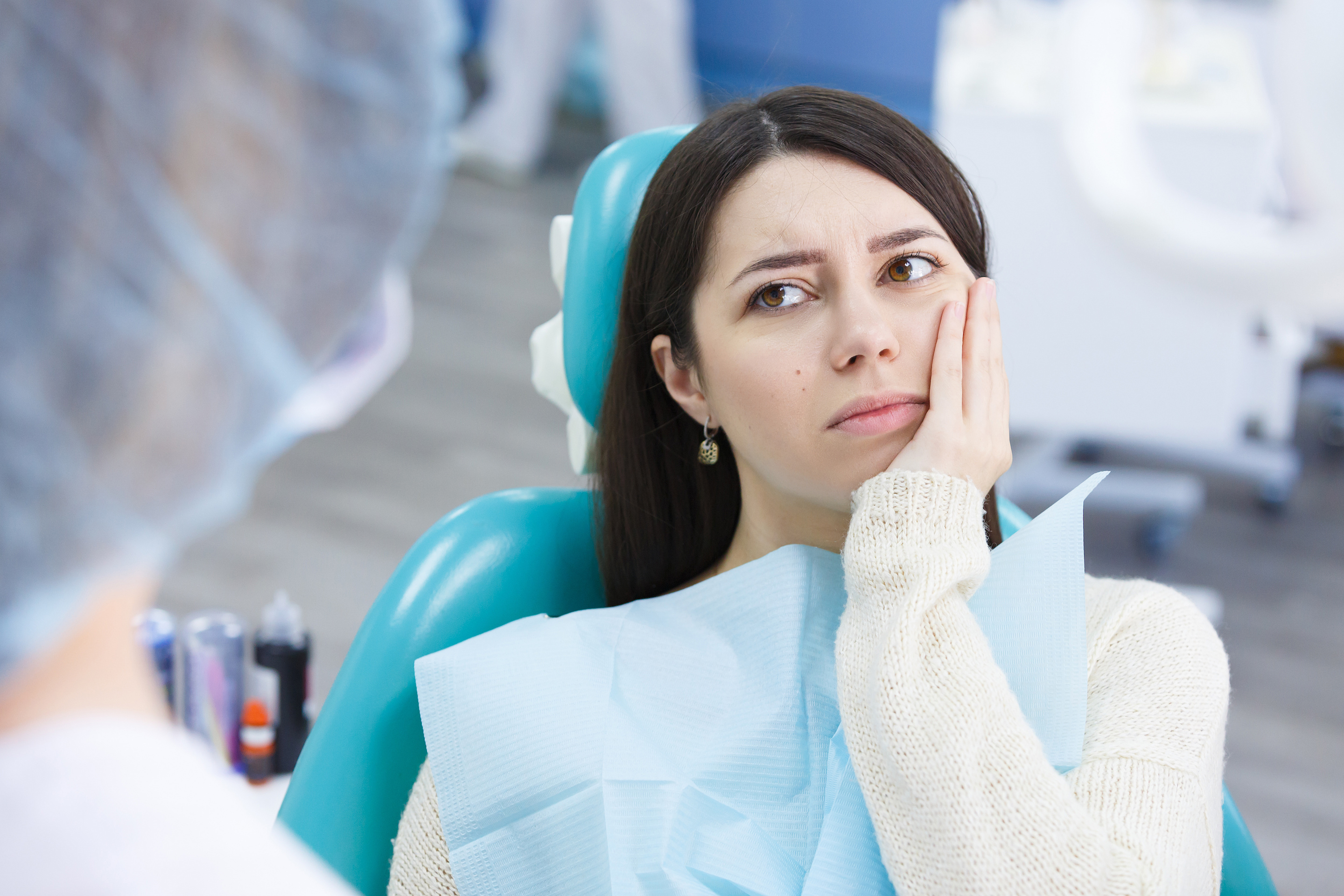 Woman at dentist with root canal pain