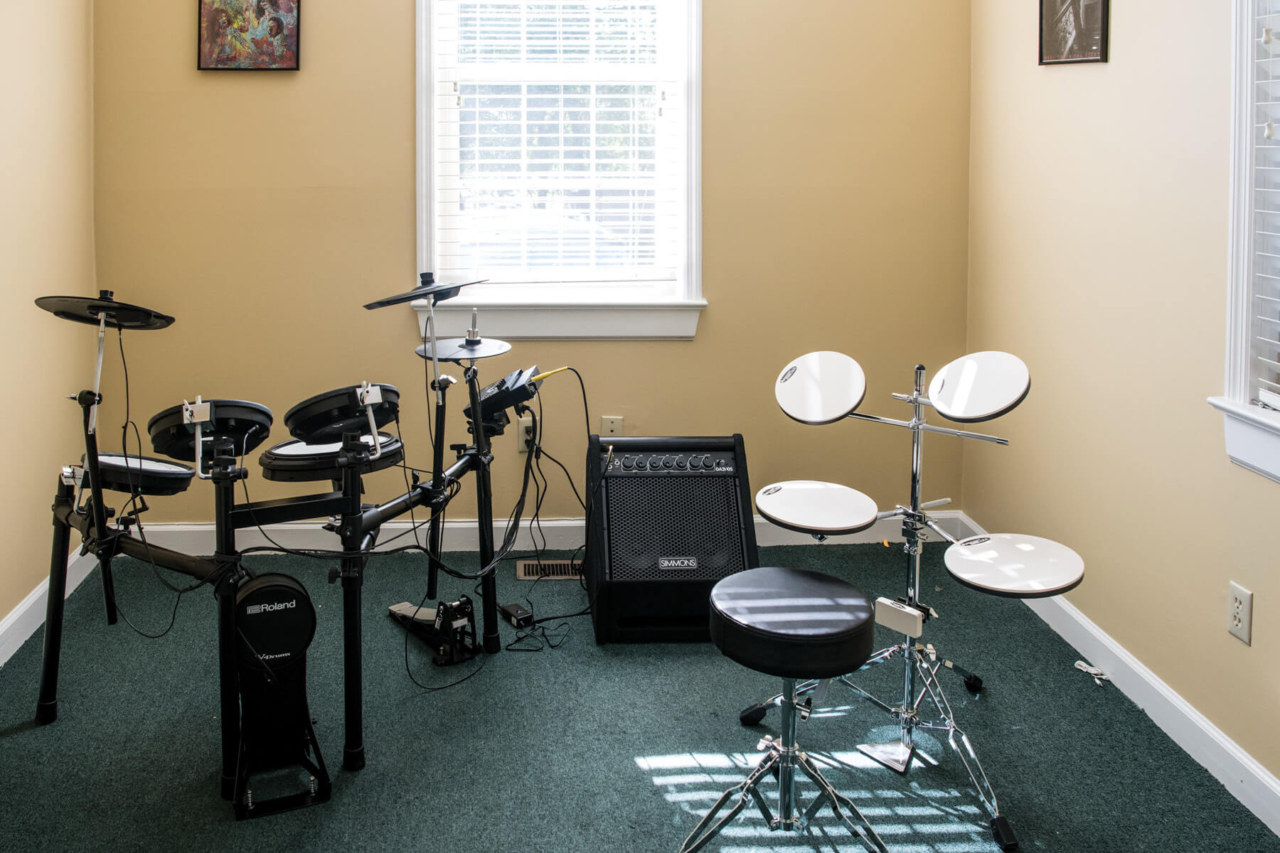 Irmo Music Academy lesson room with drum kits.