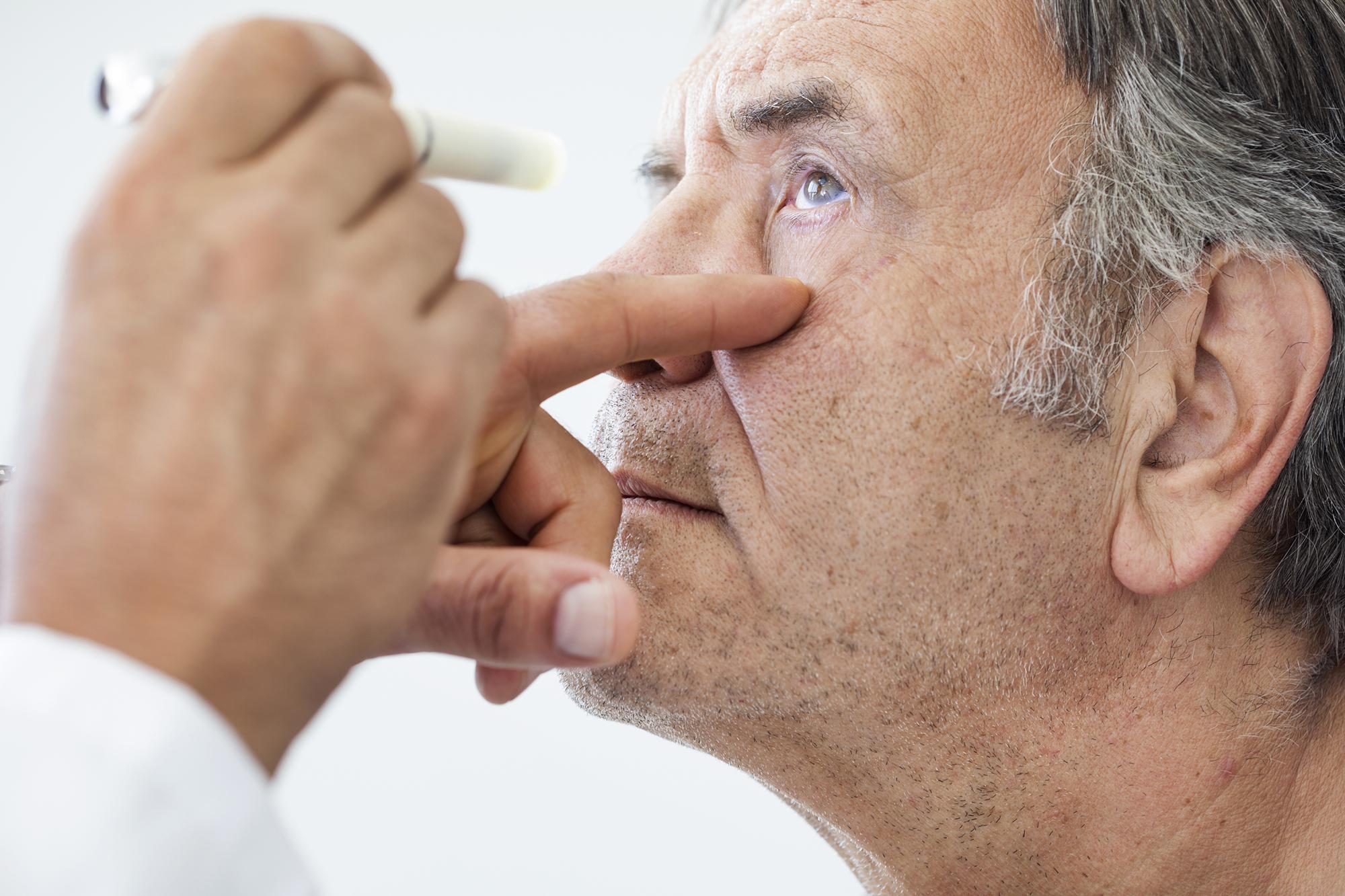 Man receives an eye examination