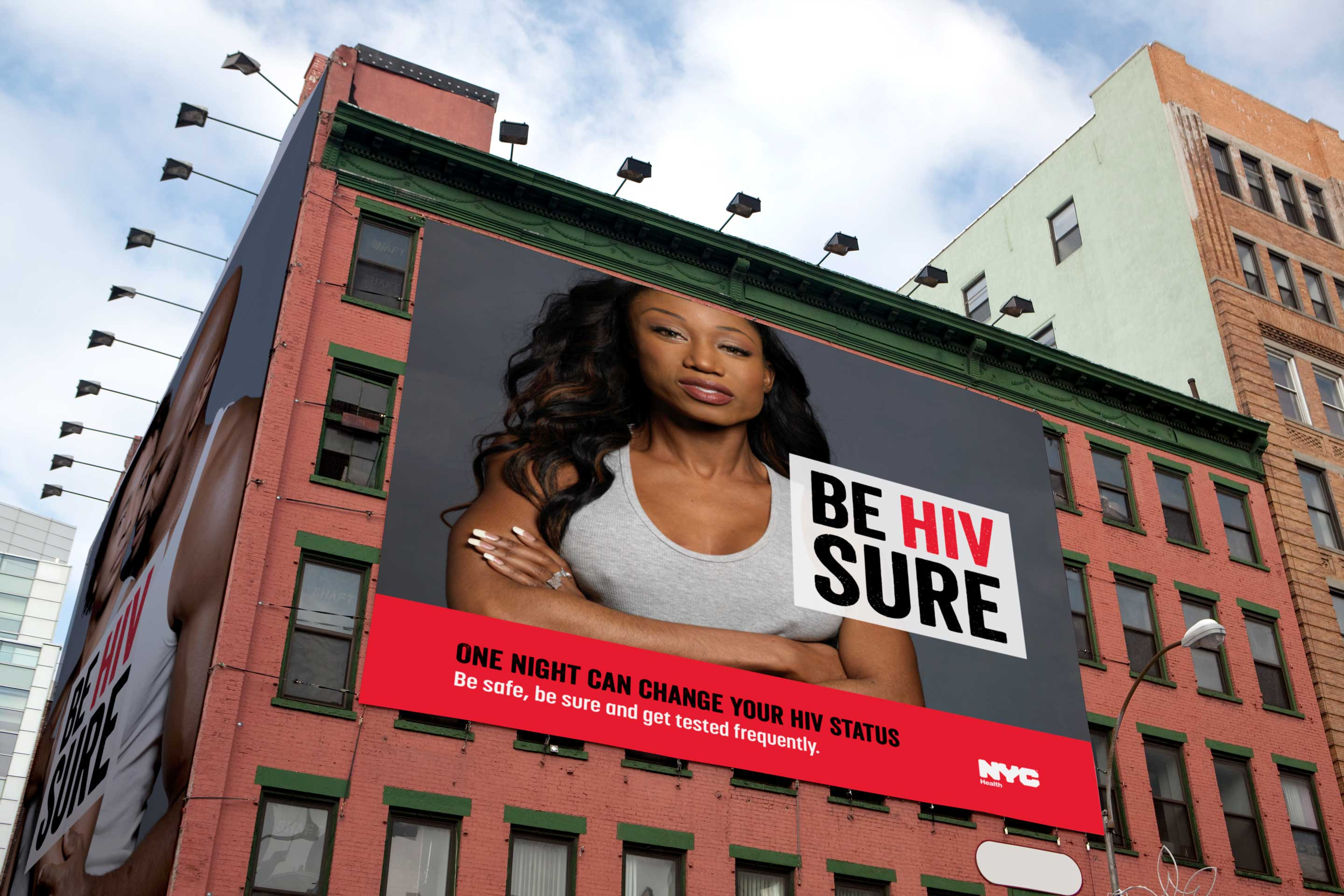 "NYC HIV Awareness billboard ad on a building of a confident African American woman crossing her arms that says ""Be HIV Sure"""