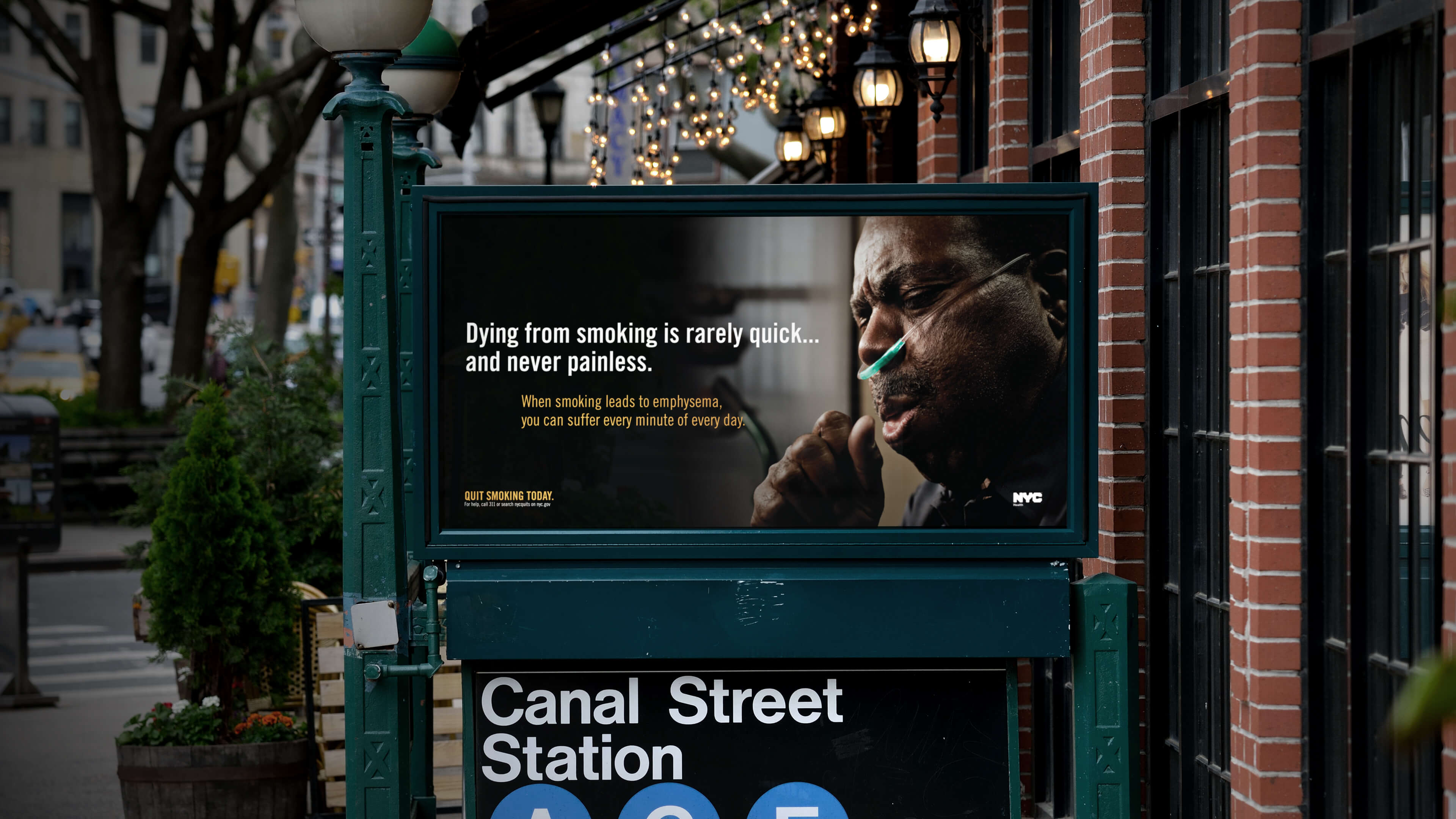 "NYC anti-smoking subway ad of a man struggling to breathe that says ""Dying from smoking is rarely quick and never painless."""