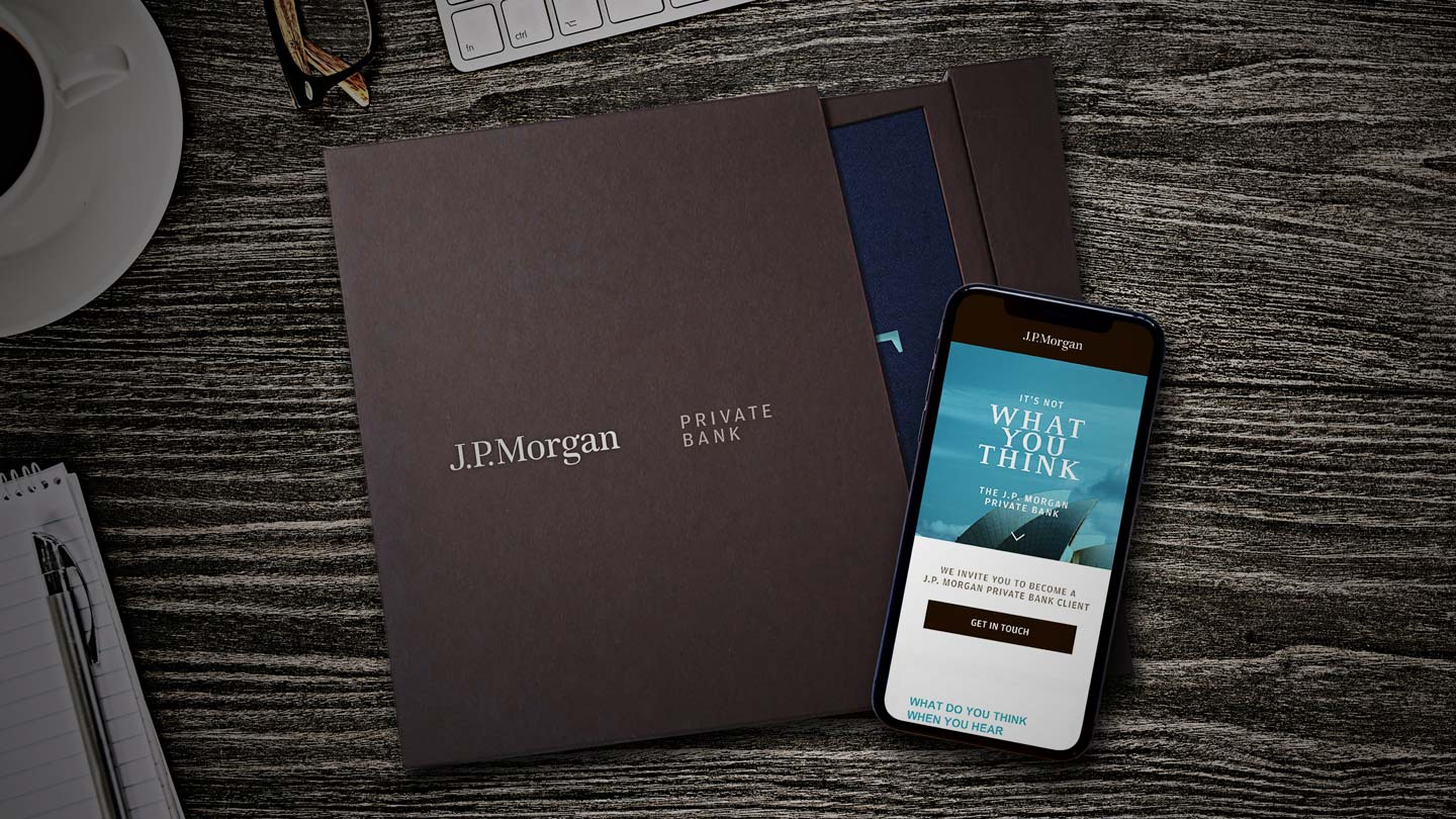 Branding for J.P. Morgan Private Bank with its logo on a dark brown folder and its website design on a mobile phone