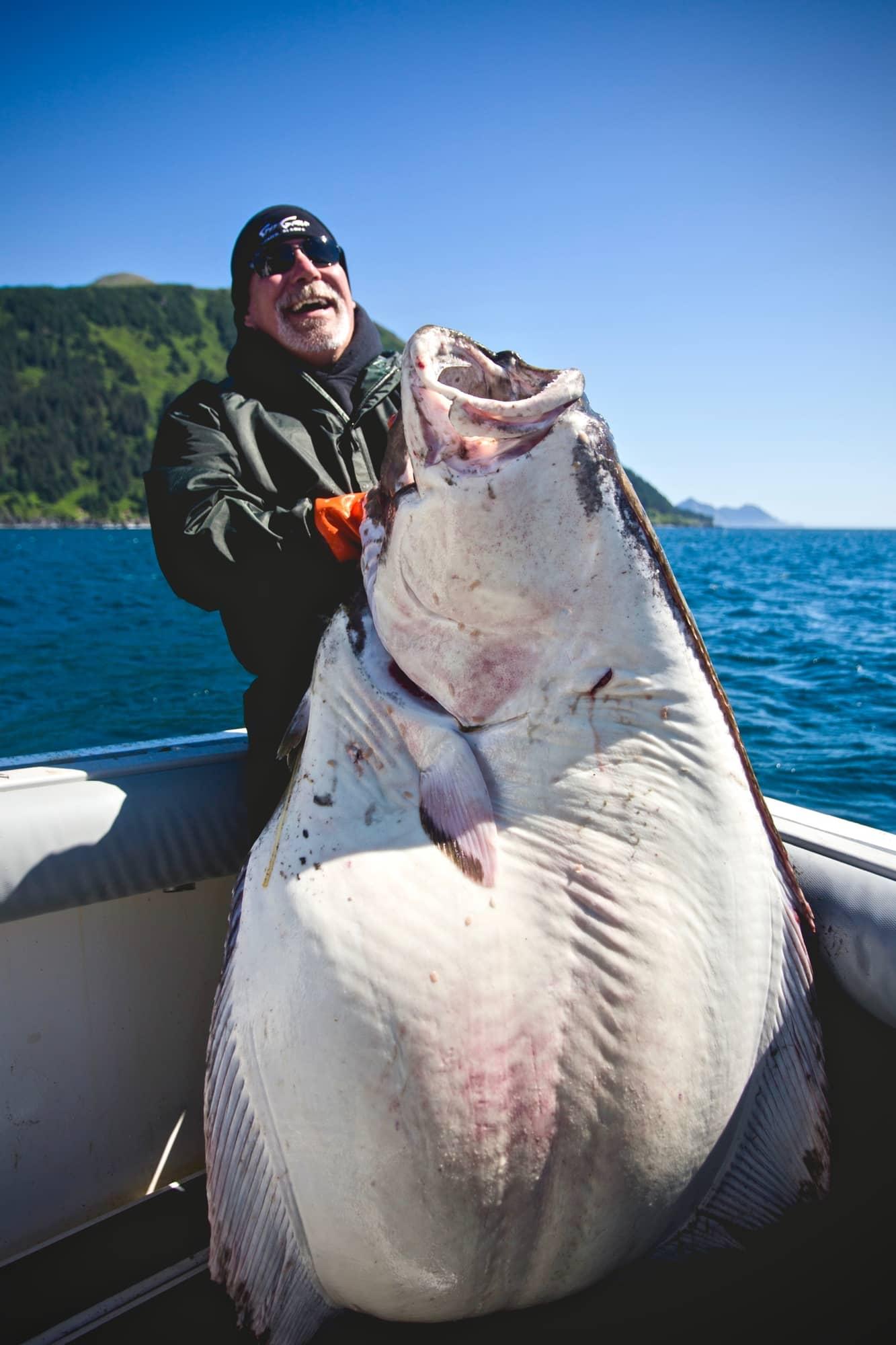 Man unable to lift massive halibut